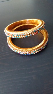 Gold silk thread bangles with multicolour stones